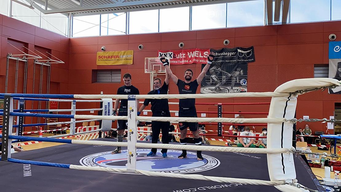 Fighter raising hands after winning